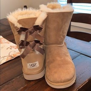 Ugg boot with back lace up bow